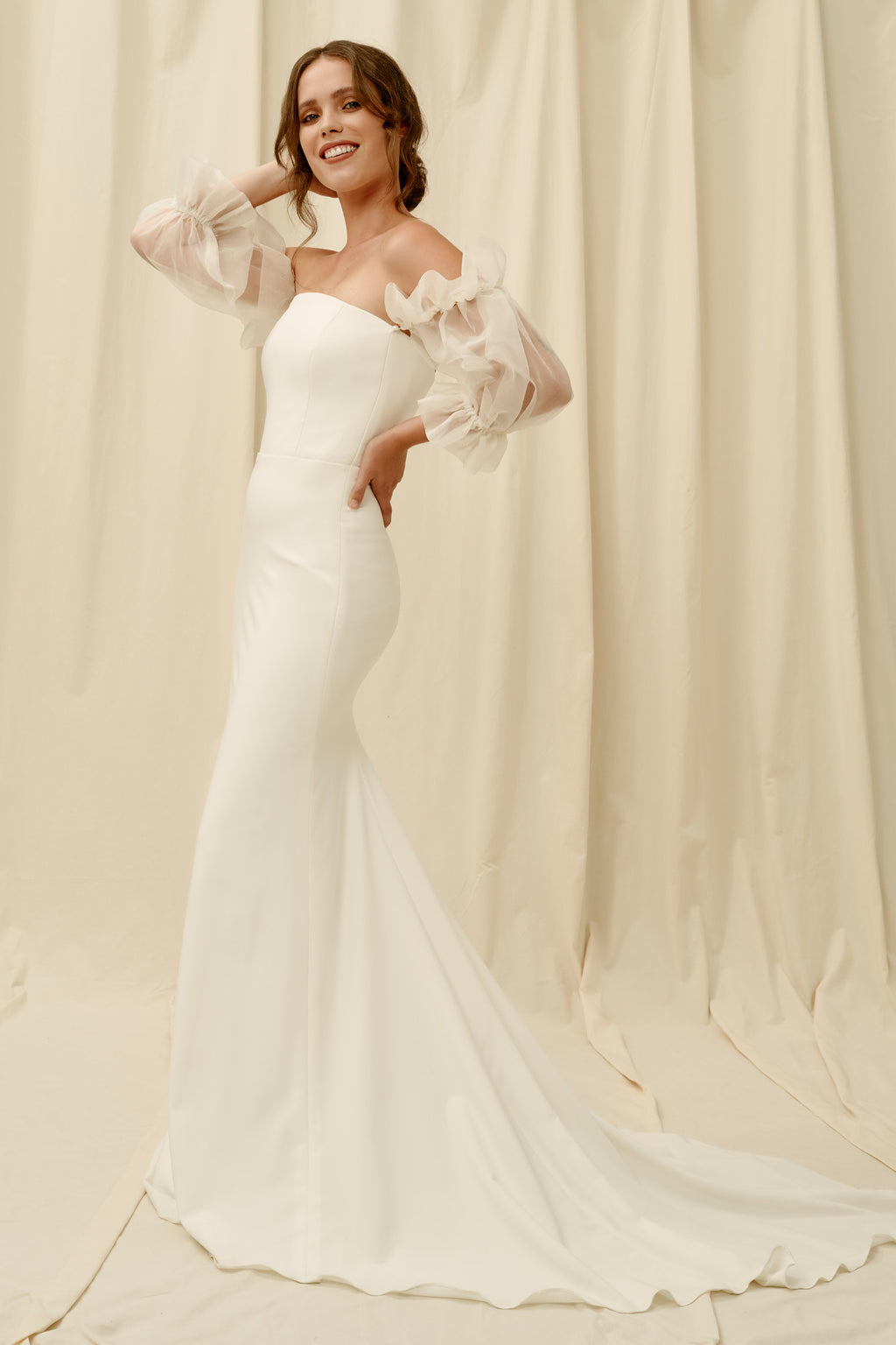Strapless crepe wedding dress with removable puff sleeves