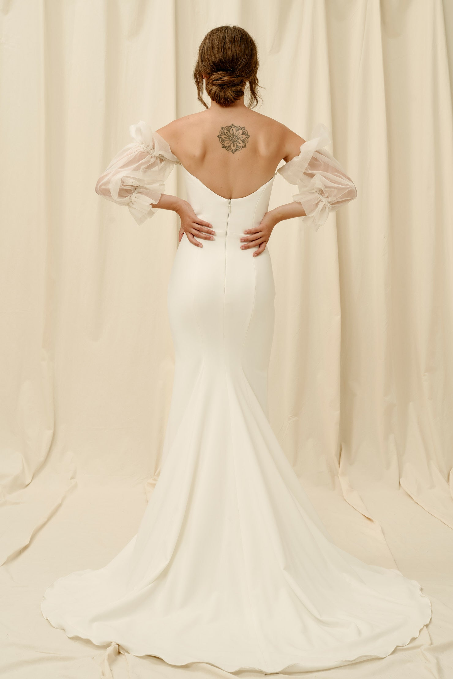 Low back crepe wedding dress with sleeves