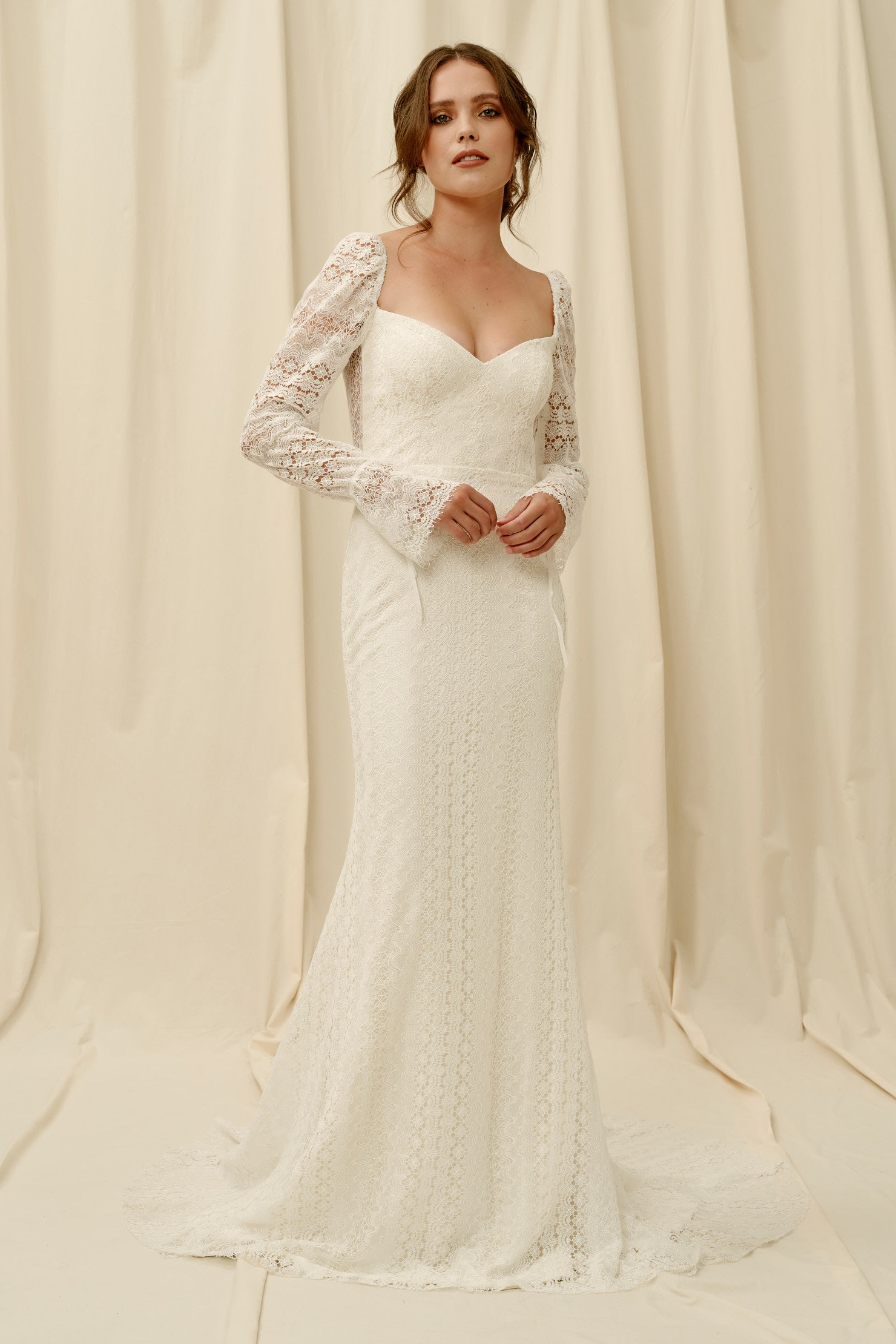 Backless lace wedding dress with sleeves