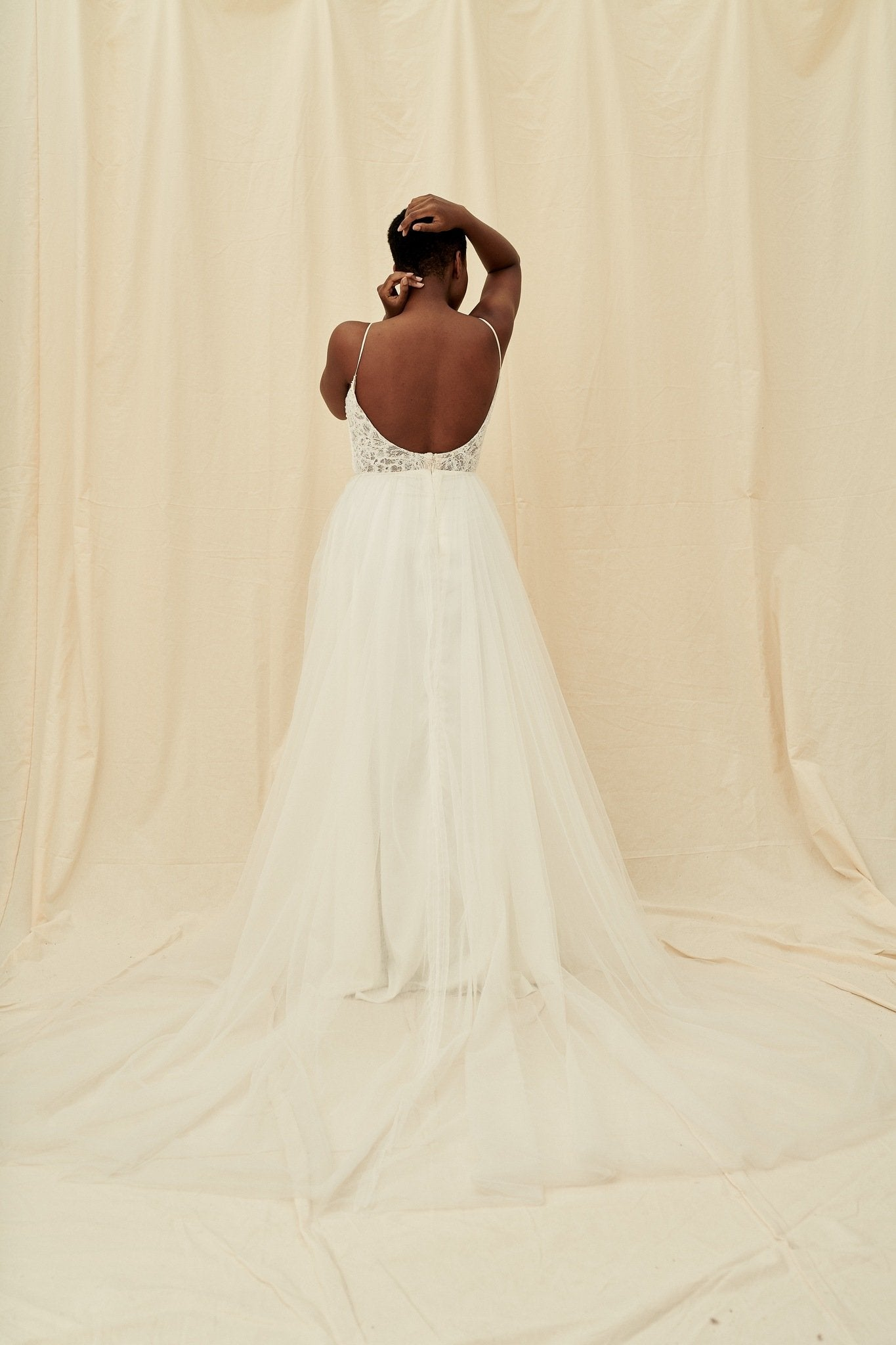 A scoop back dress with a plunging beaded bodice and a princess tulle skirt by Truvelle