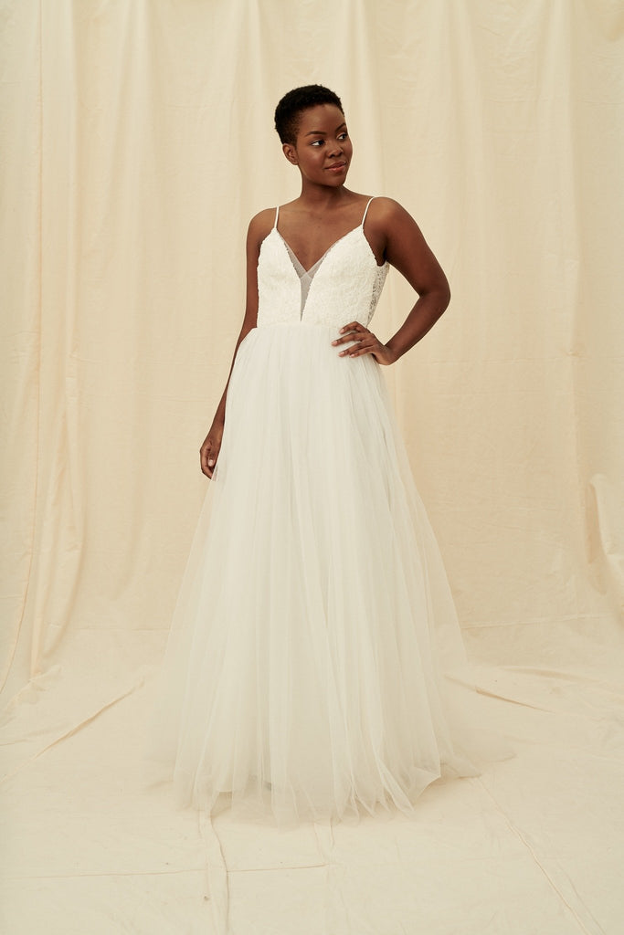 A scoop back dress with a plunging beaded bodice and a princess tulle skirt