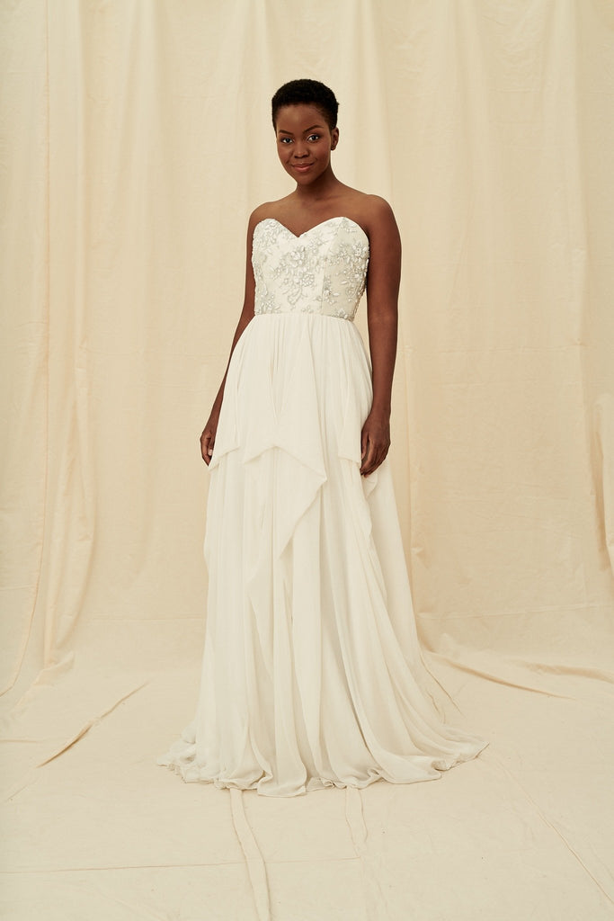 Strapless sweetheart wedding dress with silver grey beading and a flowy chiffon skirt