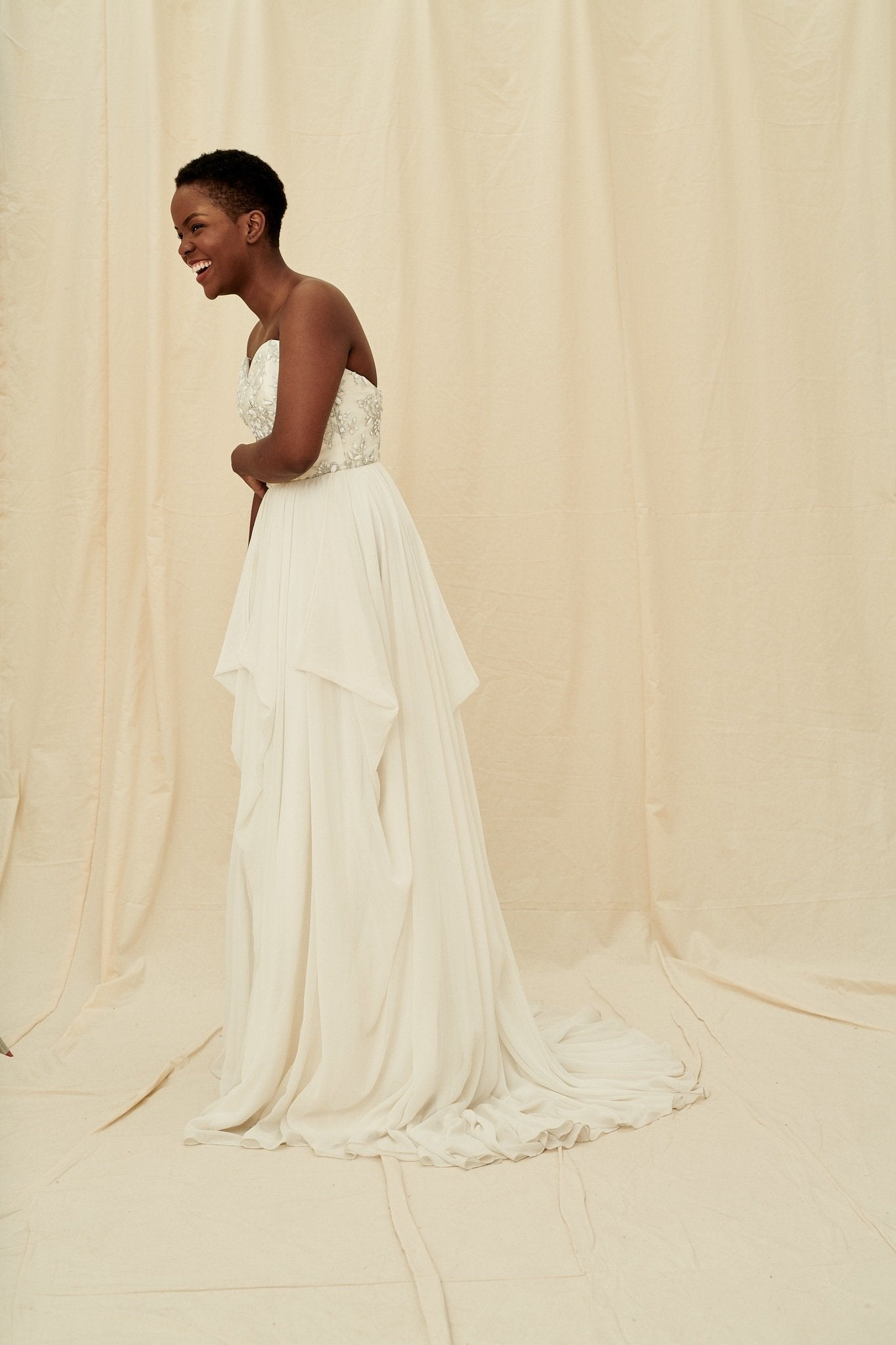 Strapless sweetheart wedding dress with silver grey beading and a flowy chiffon skirt by Truvelle