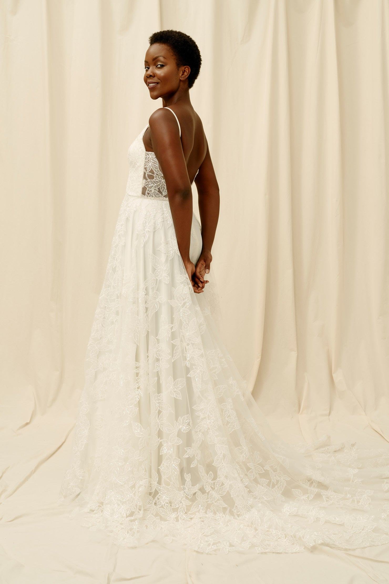 Scoop back wedding dress with a long train