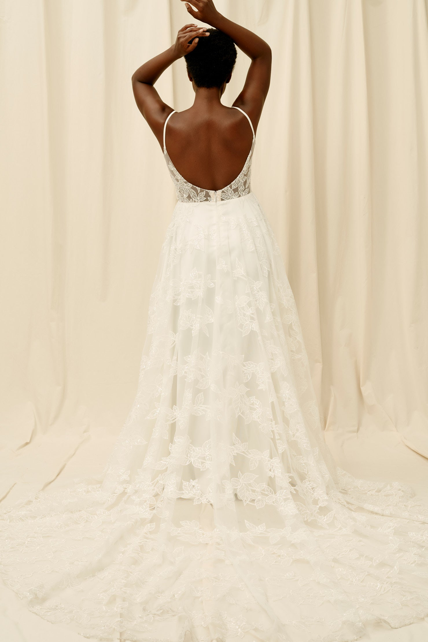 Backless wedding dress with botanical lace and spaghetti straps