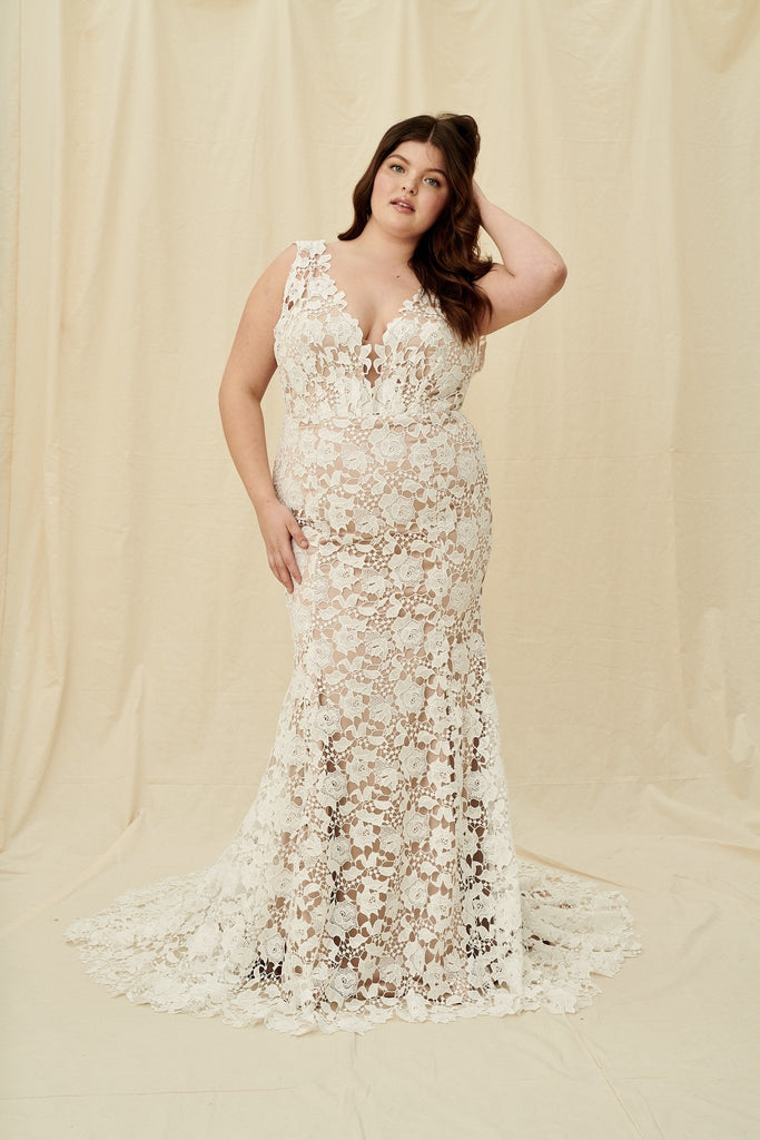 Curve size wedding dress with a train featuring bold floral lace over mocha lining