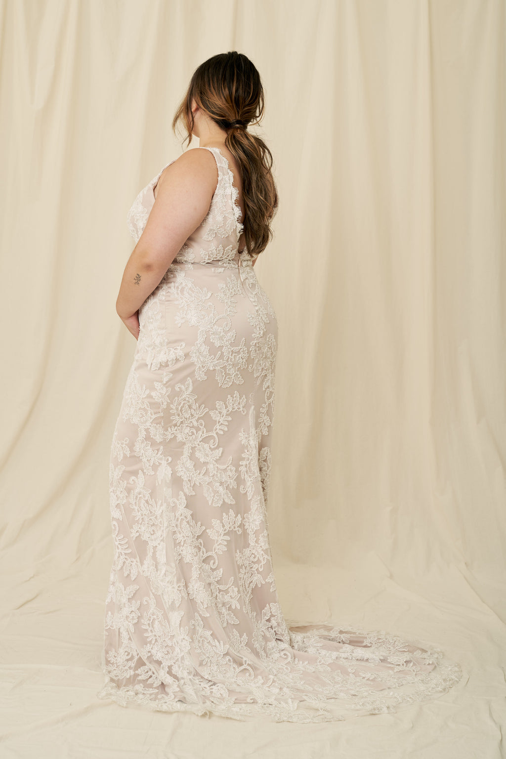 Plus size mermaid wedding dress with nude lining and beaded lace