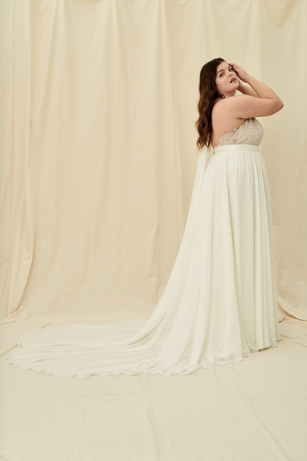 Plus size beaded halter top wedding dress with a flowy chiffon skirt