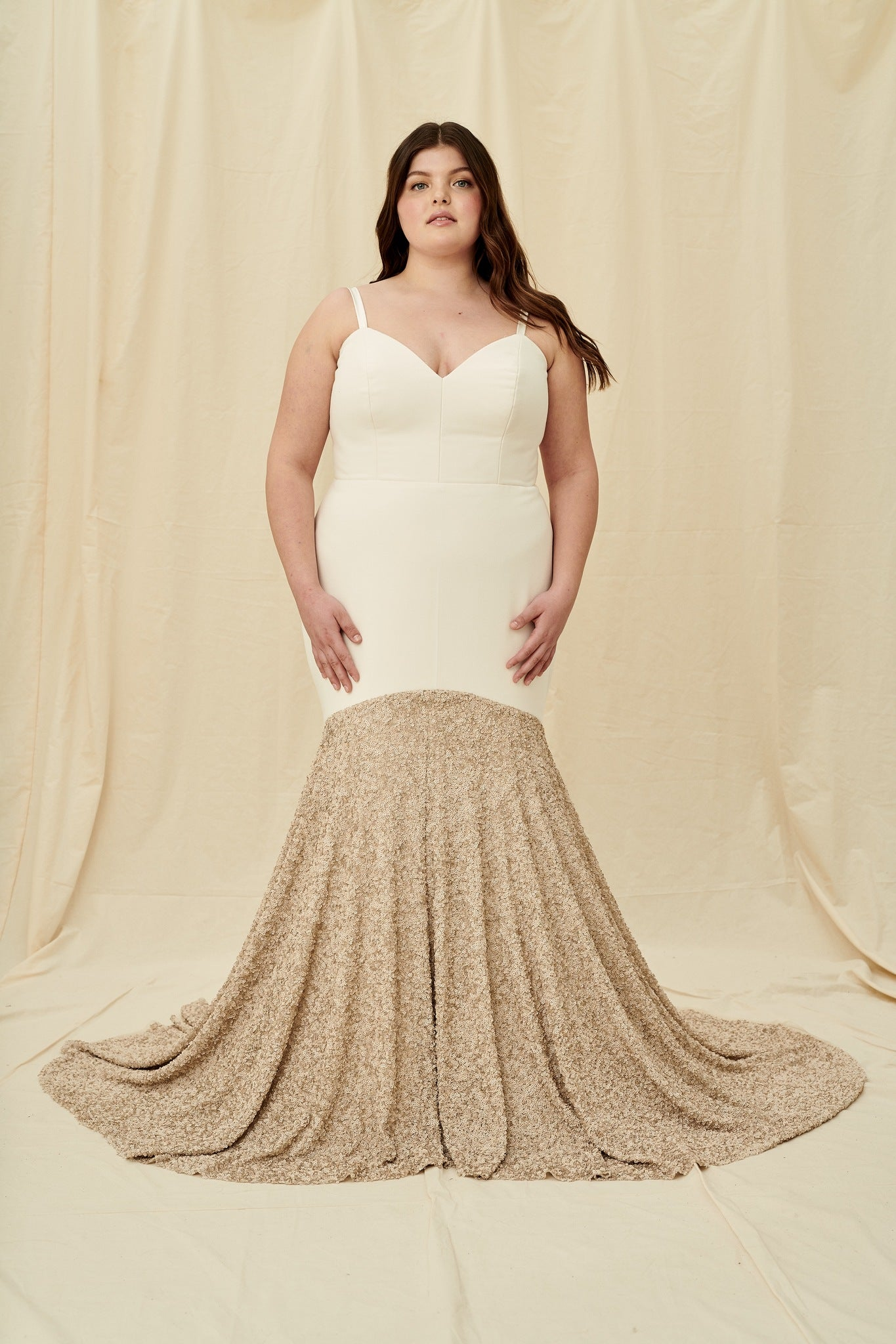 Fitted plus size crepe wedding dress with a rose gold sequin-blocked train