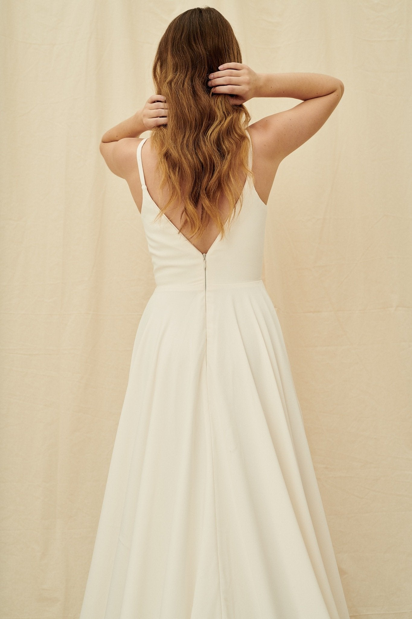 Simple crepe wedding dress with an extra long train and pockets