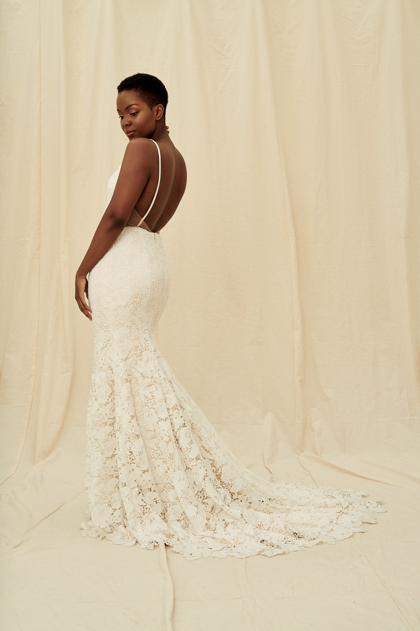 Backless lace mermaid gown available at Calgary and Vancouver bridal boutique
