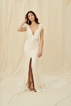 Lightweight lace mermaid wedding dress with low cut neckline ruffles and a centre slit