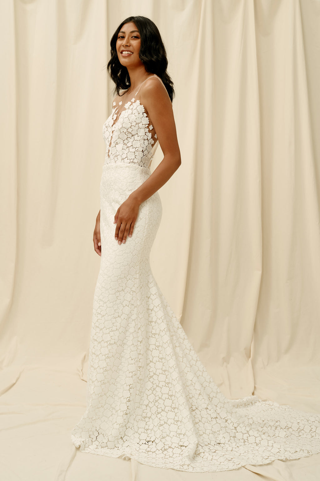 Fitted lace wedding dress with an illusion floating top
