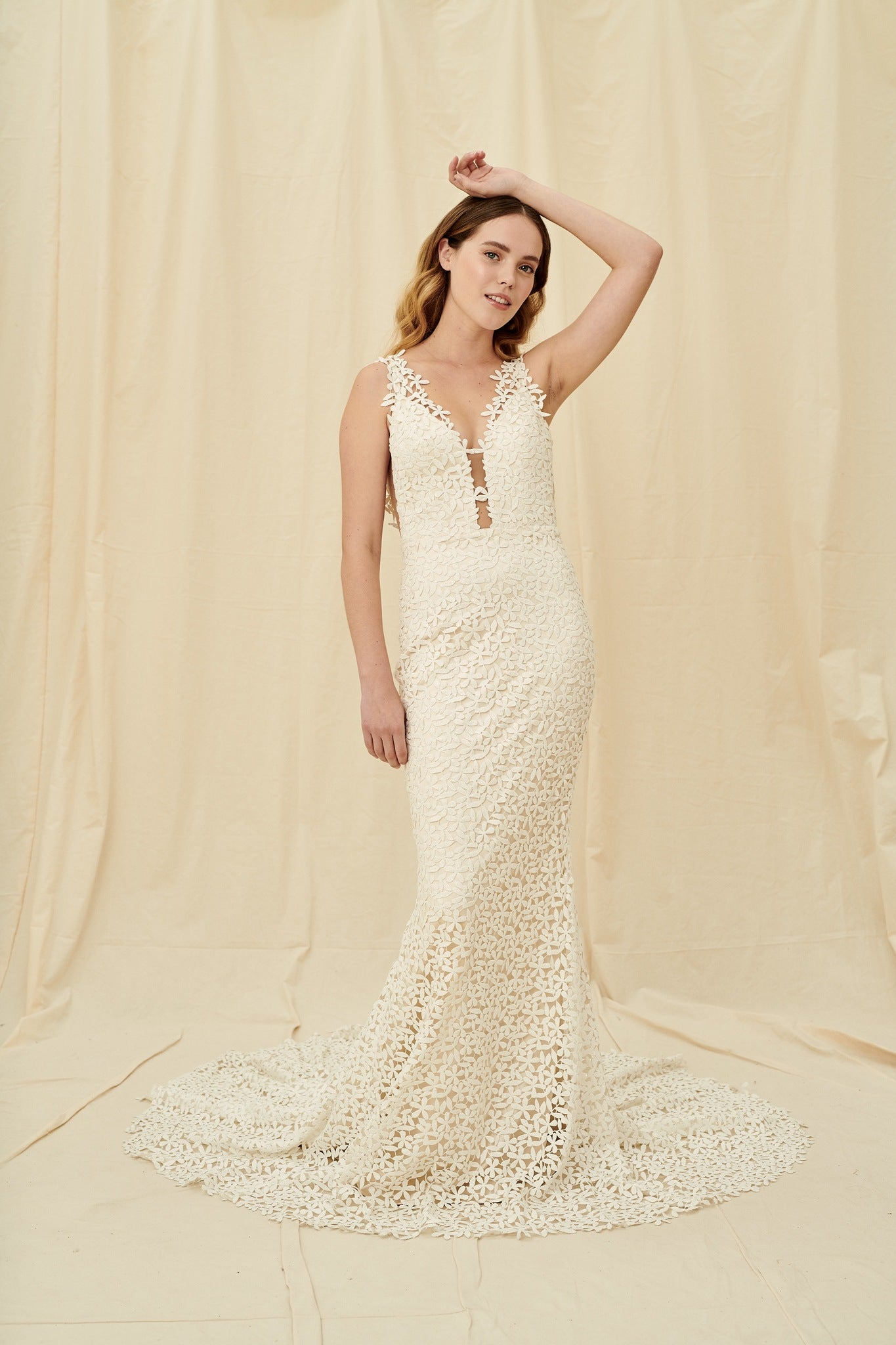 Mermaid wedding dress with all-over flower lace, a dramatic train, and a low back