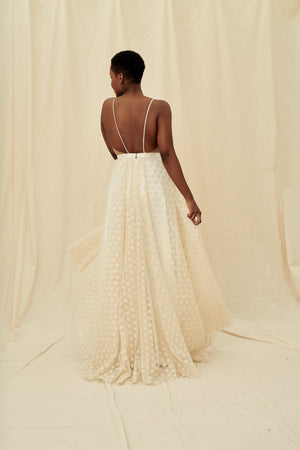 A backless, shimmery gold lace gown with spaghetti straps