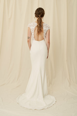Crepe mermaid wedding dress with a keyhole back and lace cap sleeves
