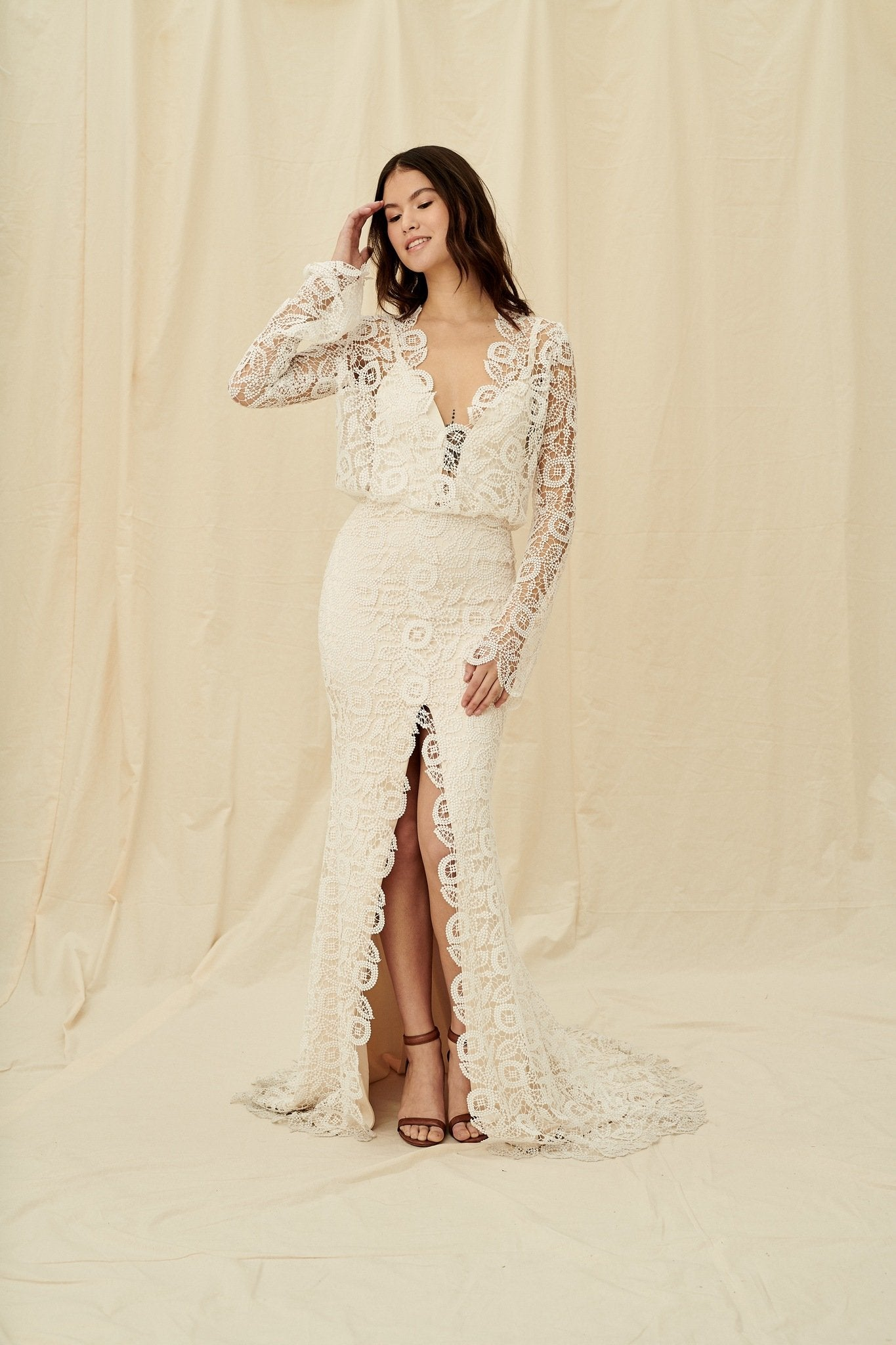 A boho mermaid dress with retro-inspired lace bell sleeves and a centre slit