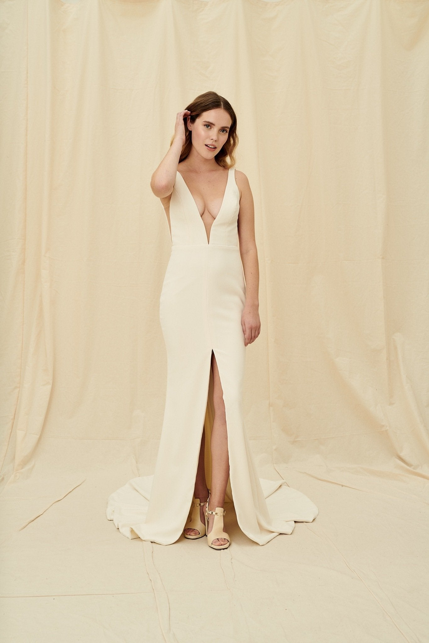 Simple crepe wedding dress with a low back and a centre slit skirt