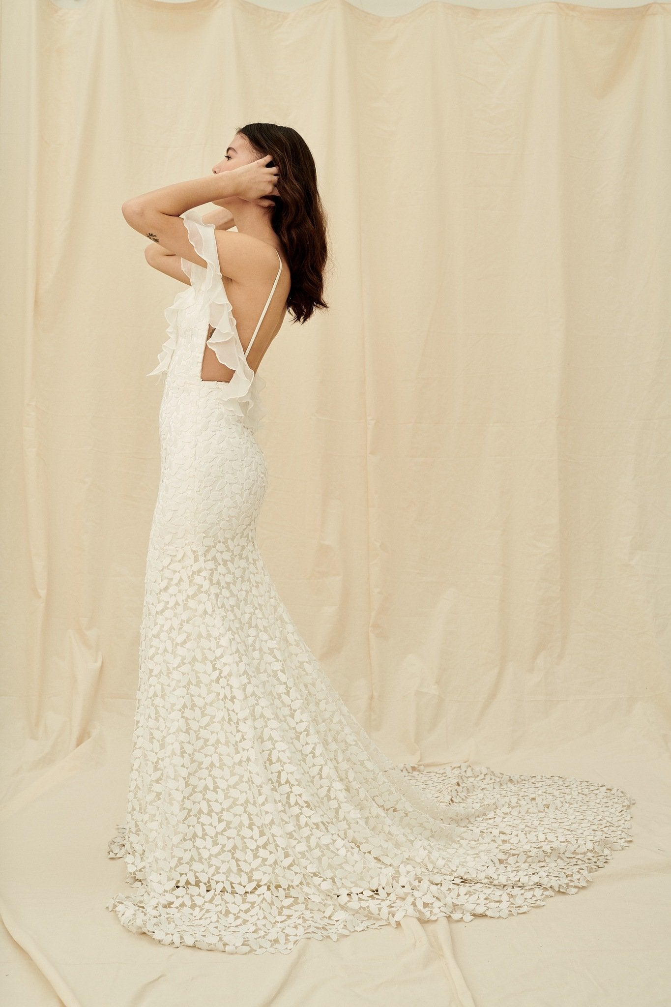 Lace mermaid gown with off-the-shoulder ruffles and a dramatic long train