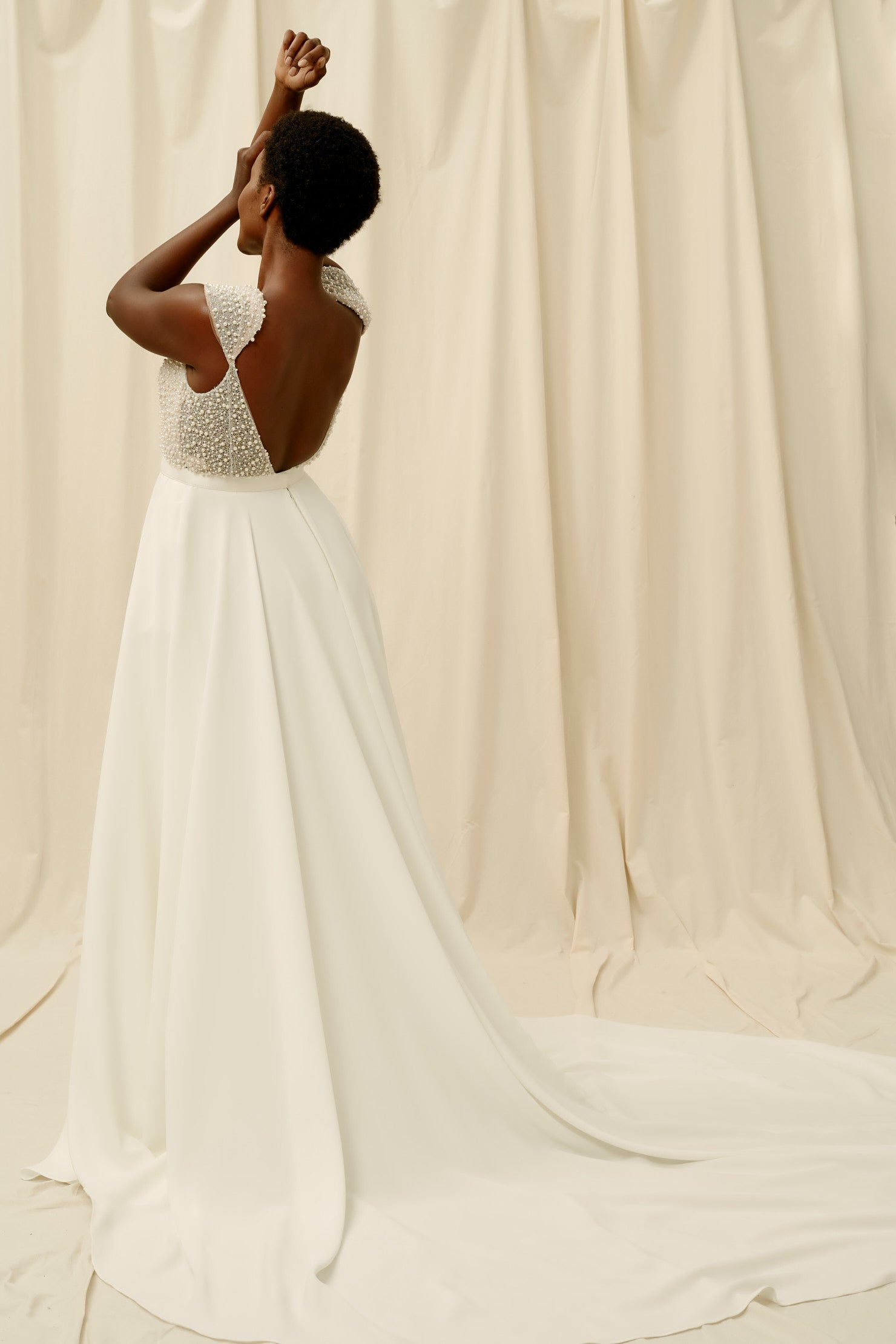 Open back wedding dress with a long crepe train