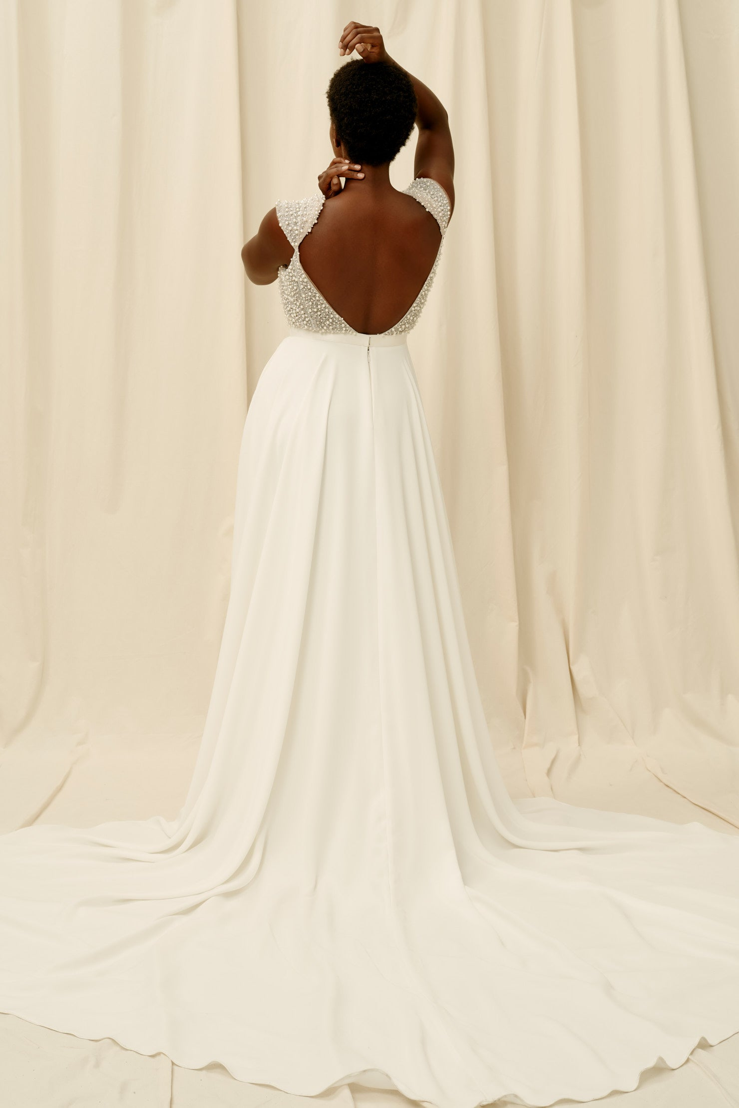 Crepe skirt wedding dress with pockets and cap sleeves