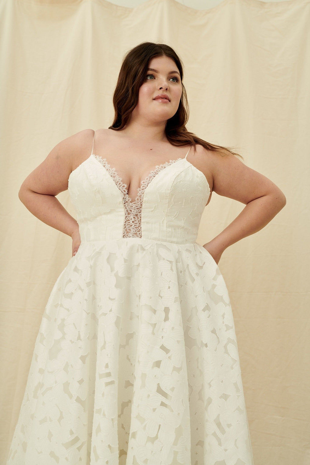 Floral print plus size wedding dress with a corset back and silk spaghetti straps