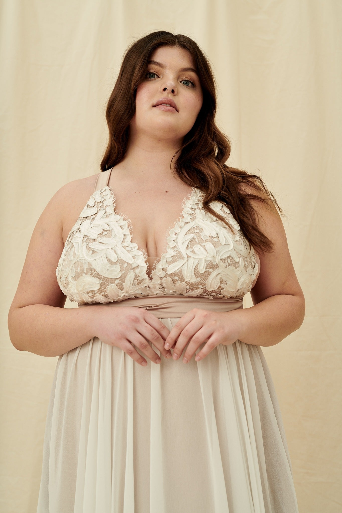 Nude lace plus size wedding dress with multiway halter straps and off-white lace