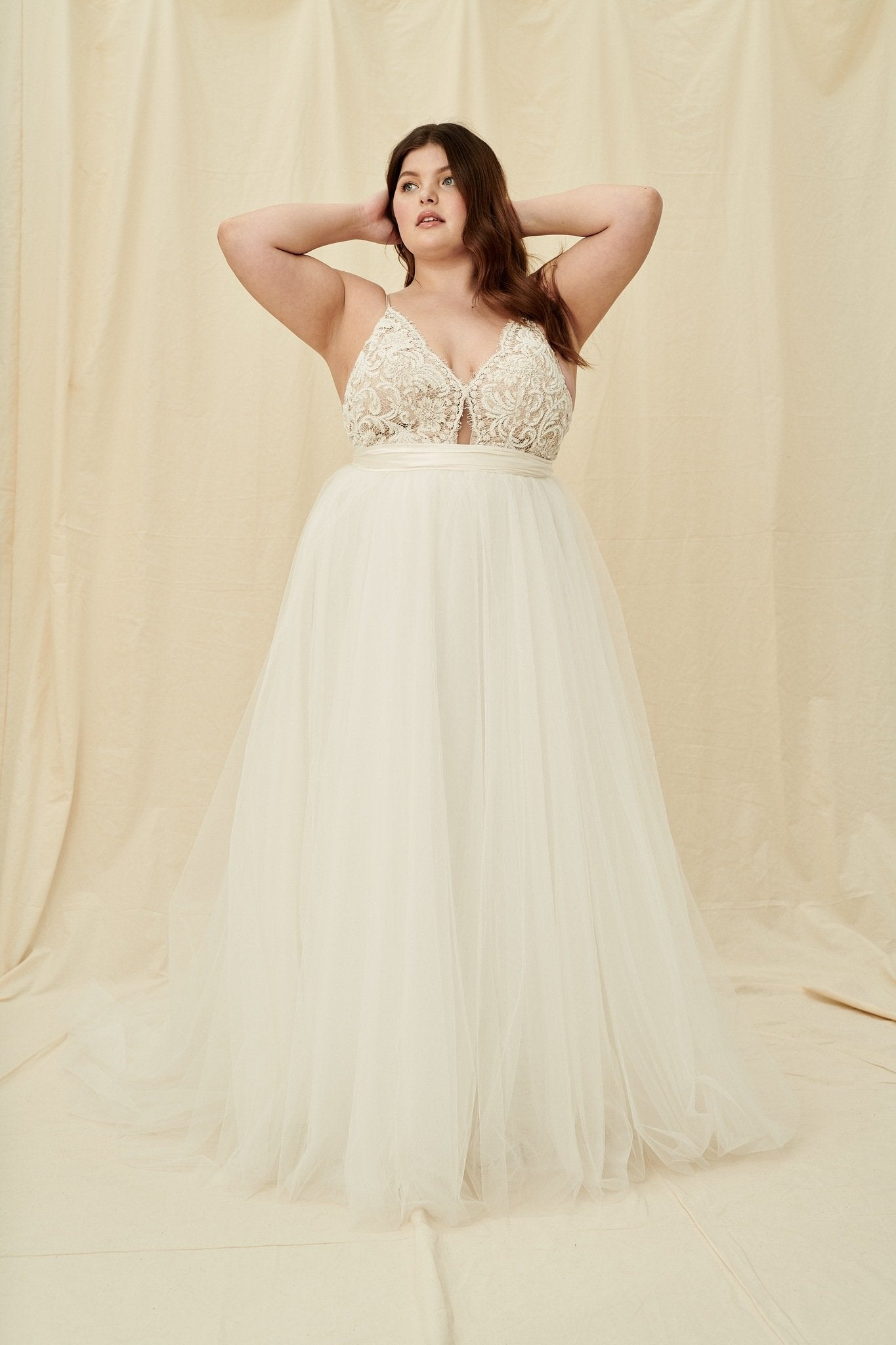 Open back plus size wedding dress with nude lining and white beading