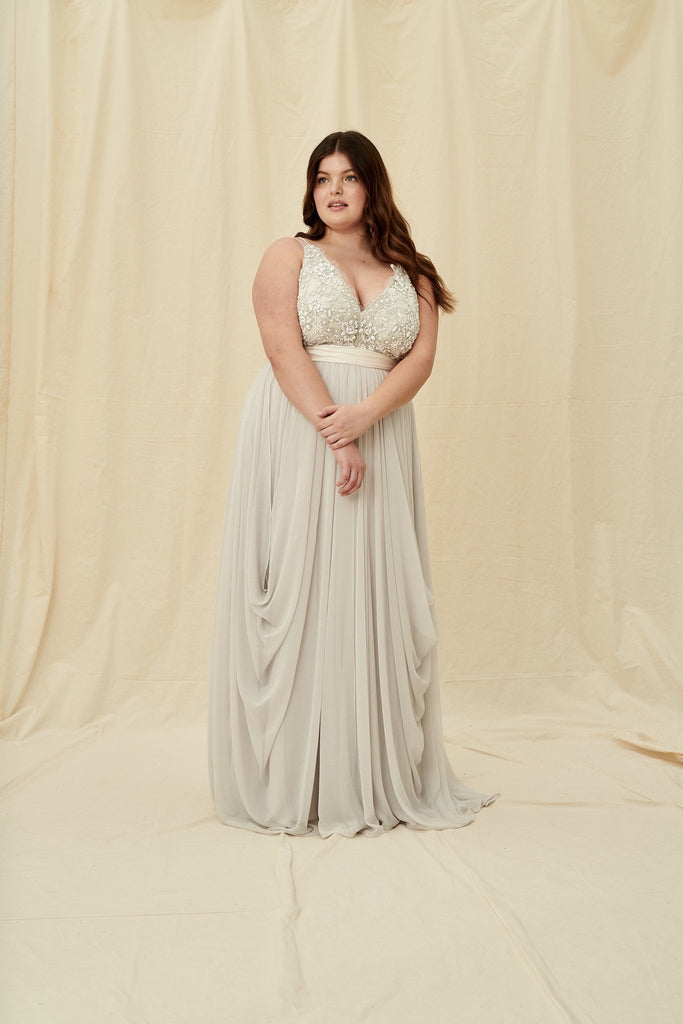 Curvy silver wedding dress with an open back and lightweight chiffon skirt