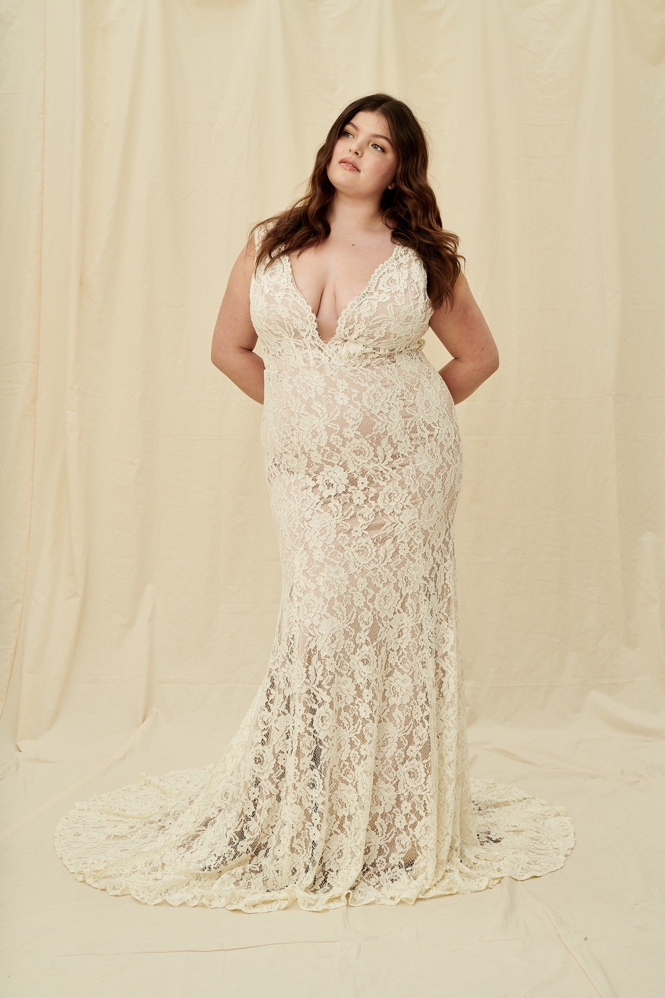 vintage-inspired plus size mermaid gown with a deep back and long train