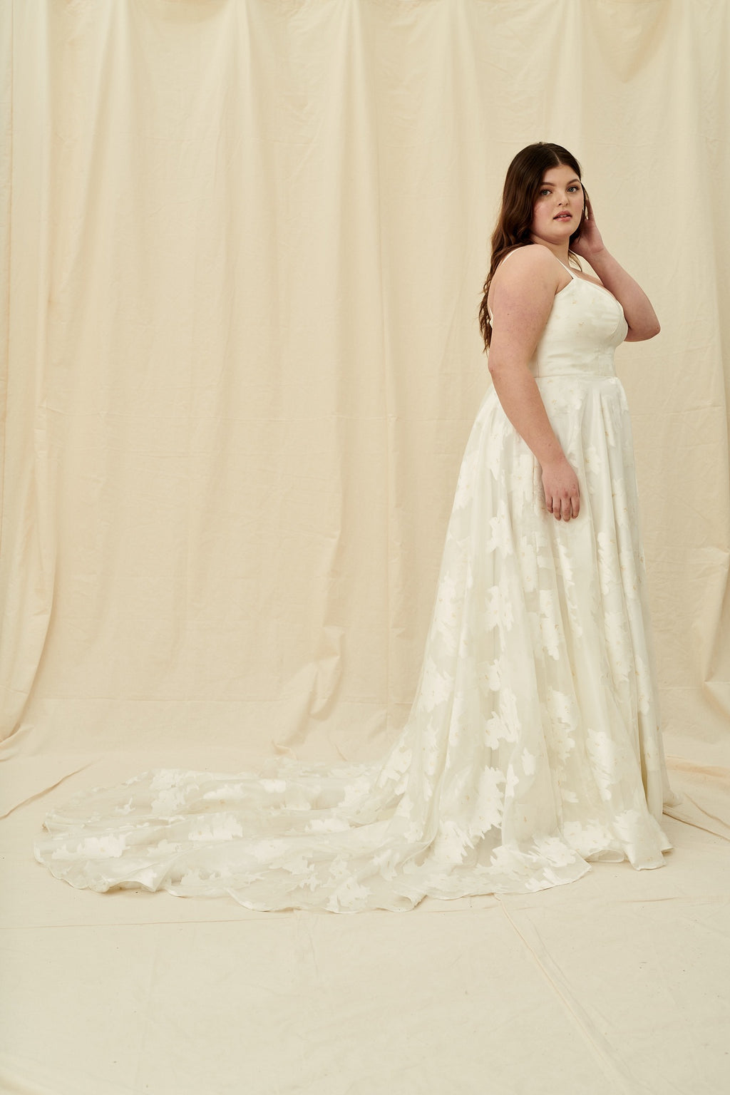 Shimmery gold organza plus size wedding dress with a corset back and long train