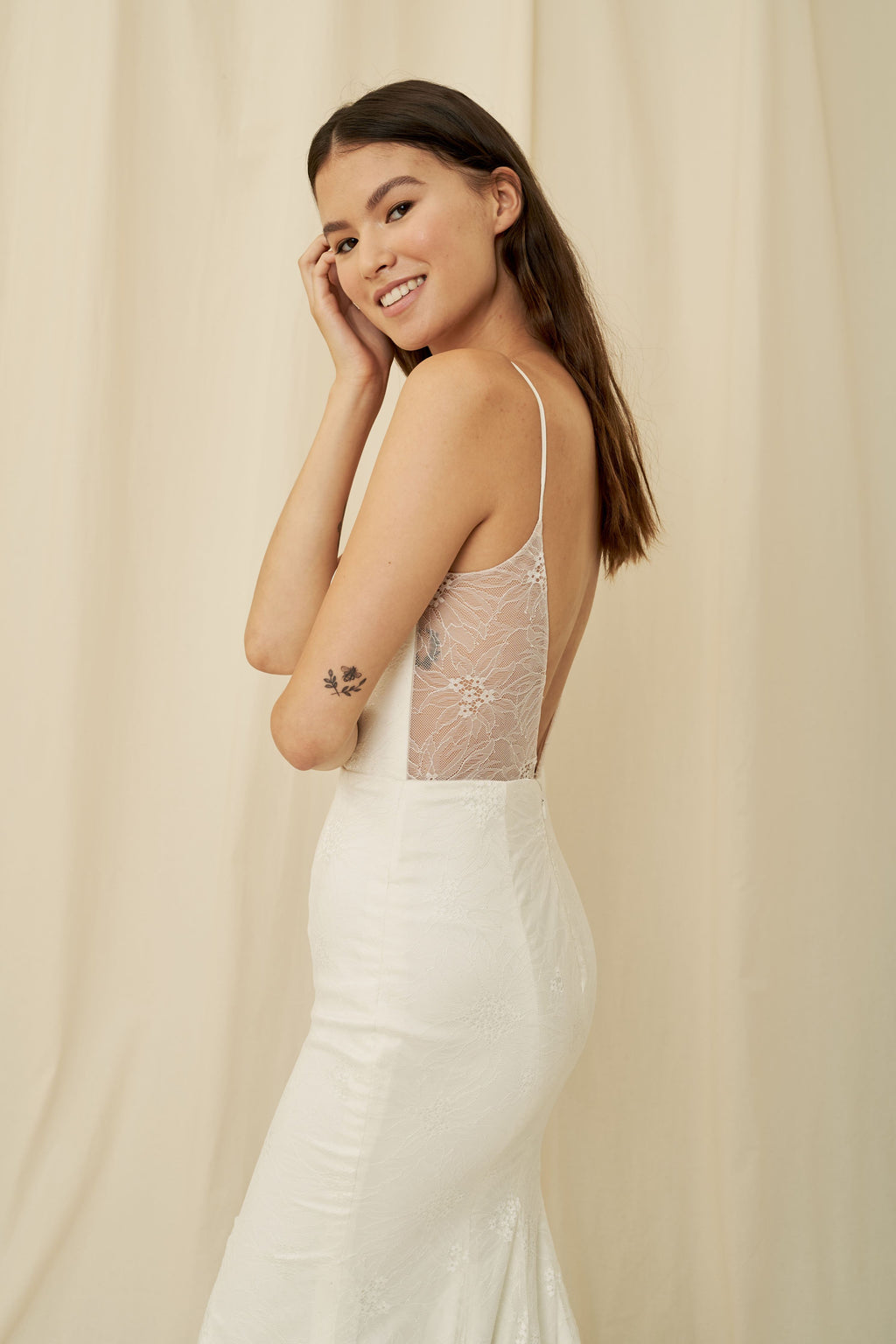 Lightweight mermaid gown with delicate lace, an open back, and a long train