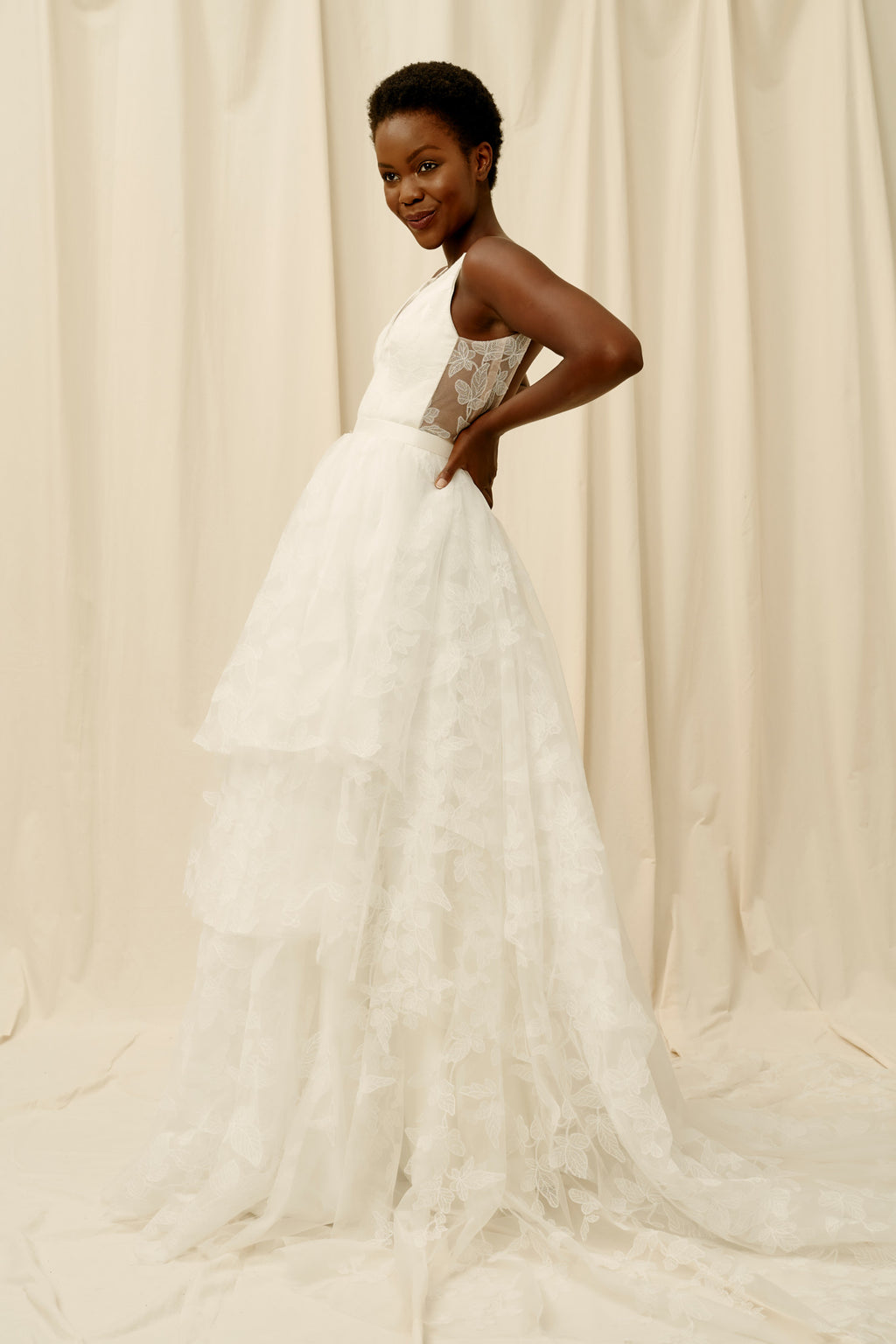 Unlined open back wedding dress with floral lace and a 3 tiered skirt