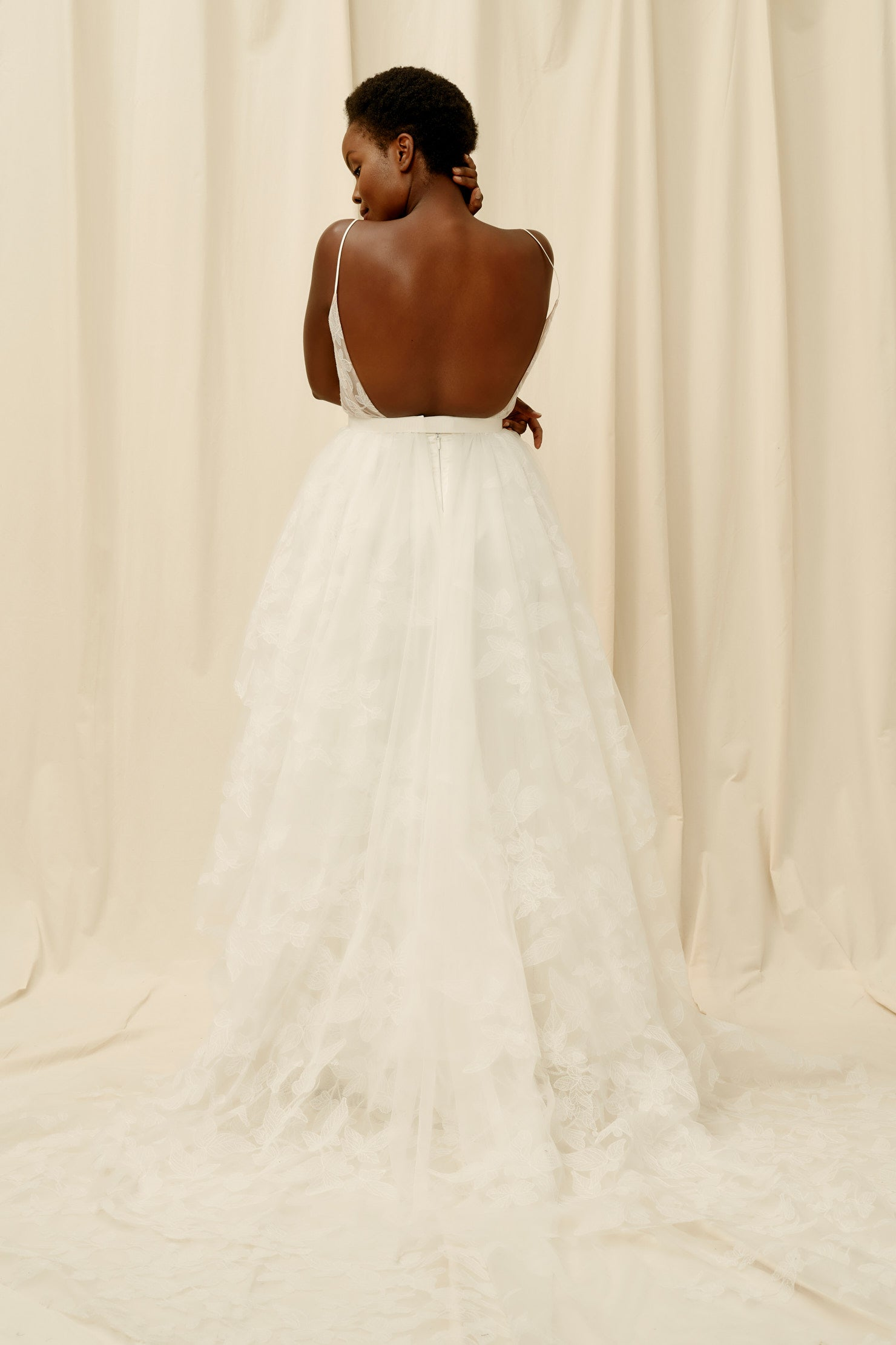 Backless wedding dress with 3 tiered skirt and unique lace