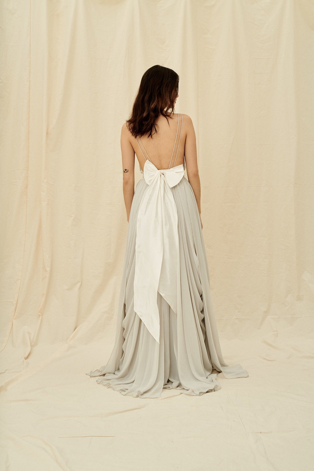 Unique grey coloured wedding dress with an open back and silver beading