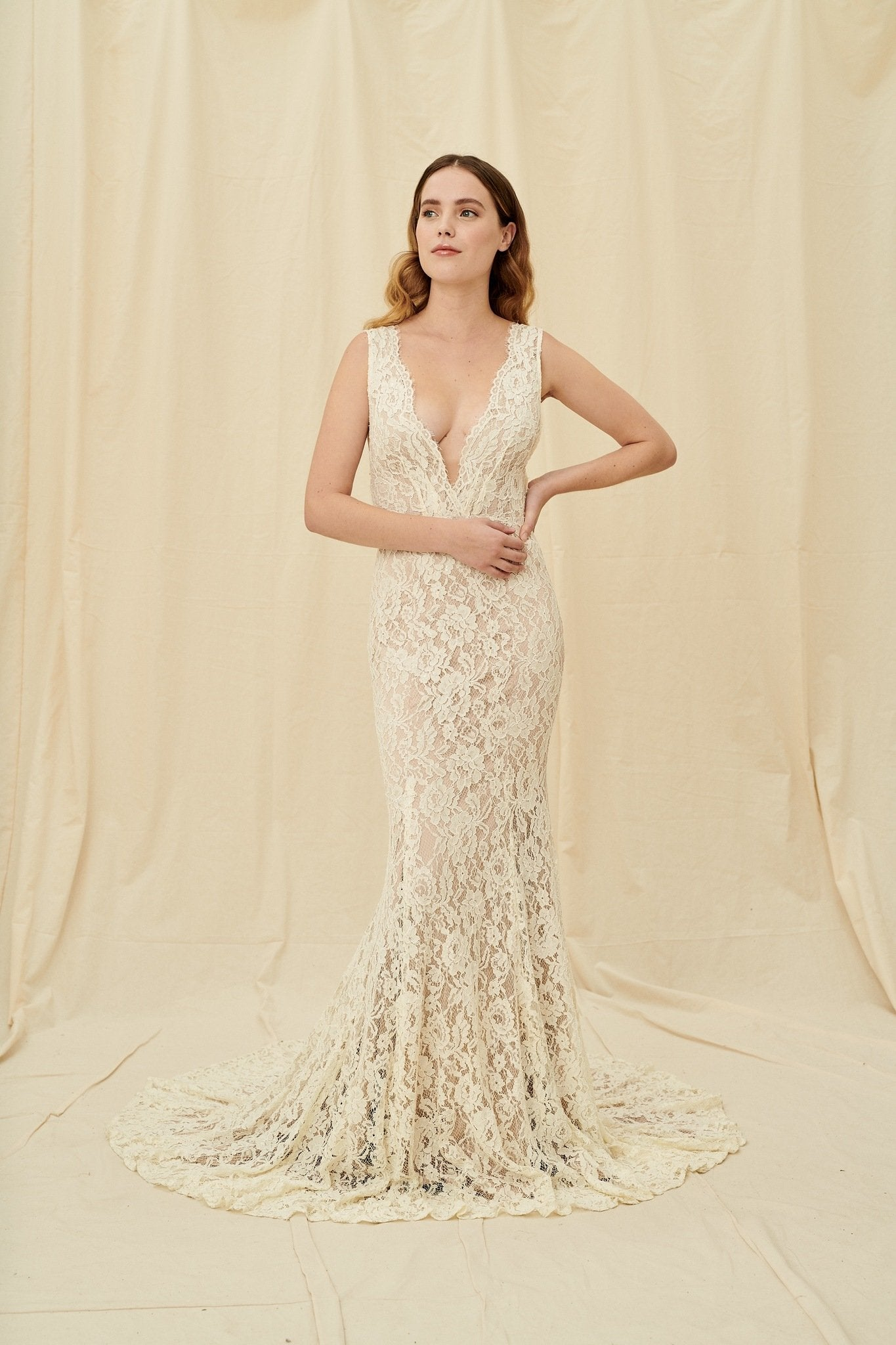 A mocha-toned, vintage-inspired lace gown with a low back and a train