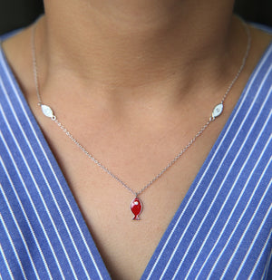 Minimalist Real Deal Red Fish Eye necklace