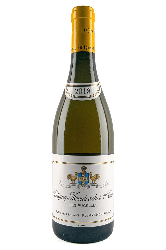 "Bottle of Domaine Leflaive, Puligny Montrachet 1er Cru ""Les Pucelles"", 2018 - Flatiron Wines & Spirits - New York"
