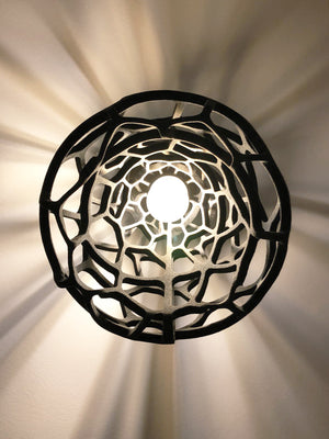 Installation of a 3D printed pendent lamp from sand