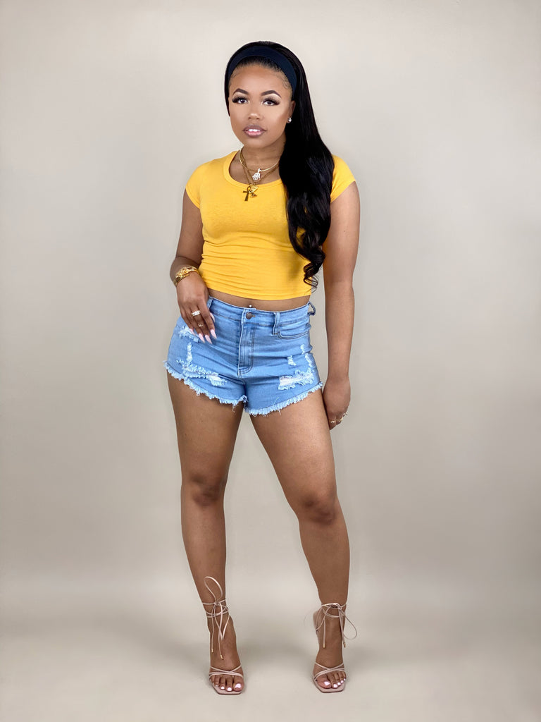 yellow crop top with denim shorts
