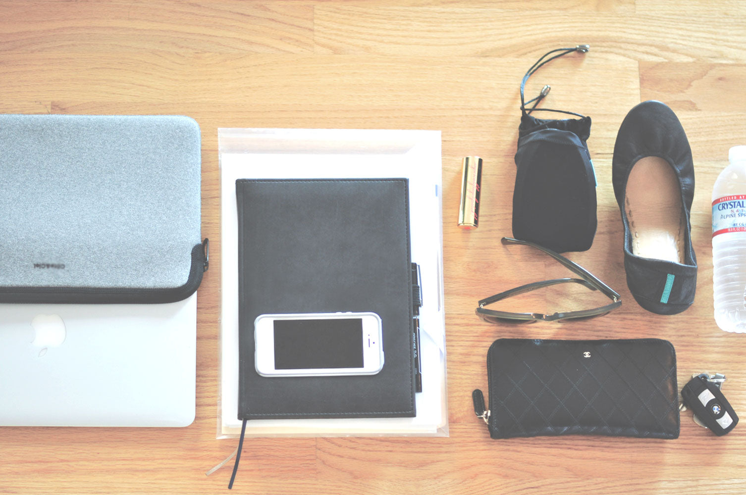 9to5Chic shares what's inside her leather laptop tote