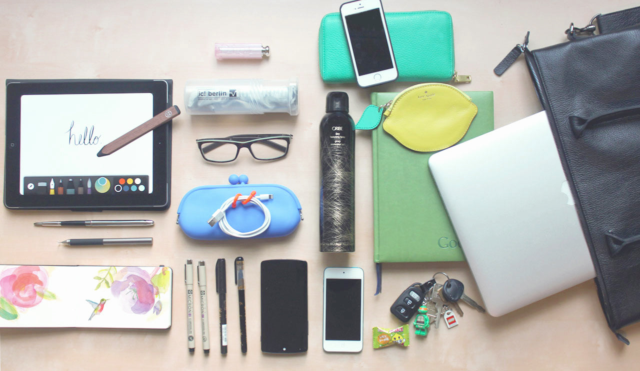 Brittany shares what's inside her leather laptop tote