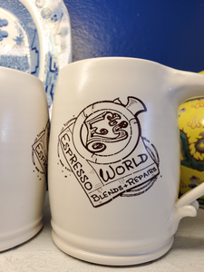 E's World coffee mug with logo of E's World Espresso Blends + Repairs..