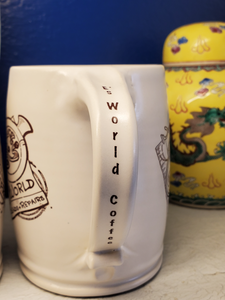 E's World Coffee mug showing handle with E's World Coffee text.