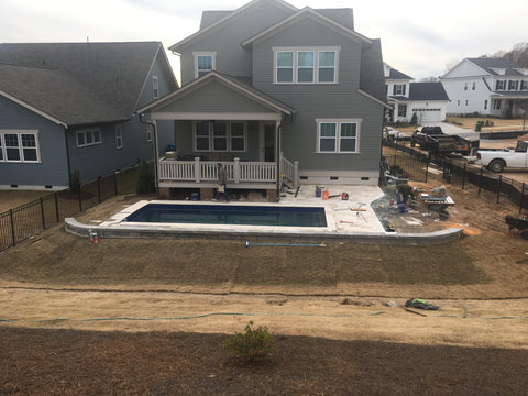 Installation of travertine decking and sod
