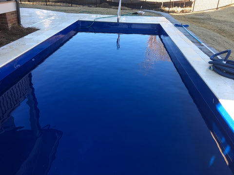 Cleaned fiberglass swimming pool