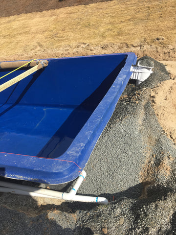 The fiberglass pool is backfilled with quarter inch sized stone to secure it in place and allow for proper drainage