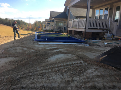 The ground around the pool is rough graded to help prepare for the decking