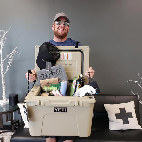 Jeff, CBD Remedies Father's Day Gift Cooler winner holding Yeti Tundra Cooler Filled with CBD