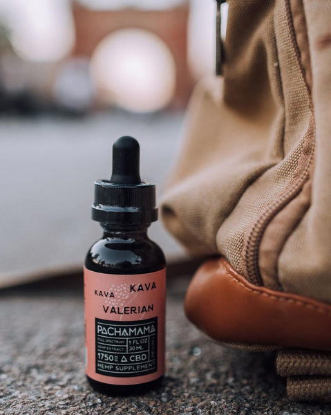 Pachamama Kava Kava Valerian Tincture next to a Back Pack
